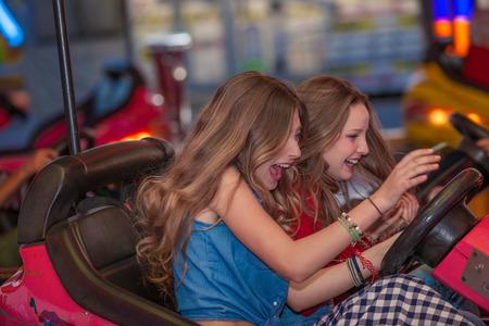 fun fair: teens having fun at the fair