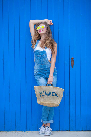 summer teen girl wearing blue denim and sunglasses. Stock Photo