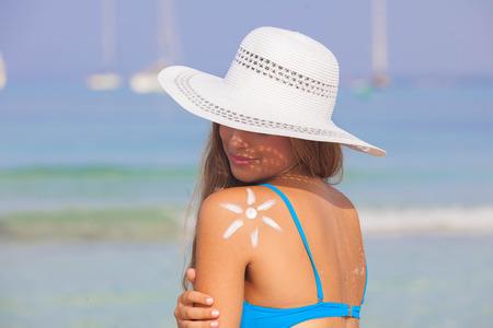 to tan: summer woman sun tan skin care concept