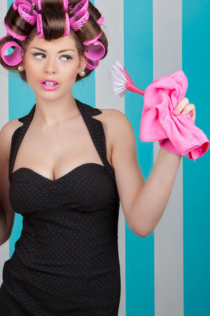 glamorous: glamorous housewife with rollers and cleaning products