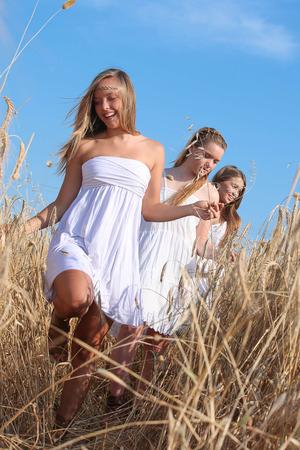healthy happy teens girls outdoors in summer. photo