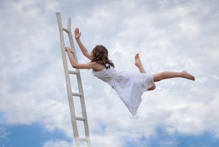 concept for effort, determination, escape, flight, escape, woman with ladder