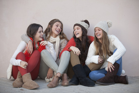 scarves: group of trendy happy teens smiling and laughing Stock Photo