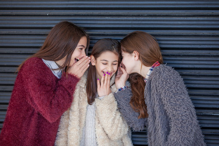 teenage girl: group kids giggling whispering secrets