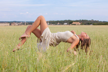 levitating: relaxation woman floating in field