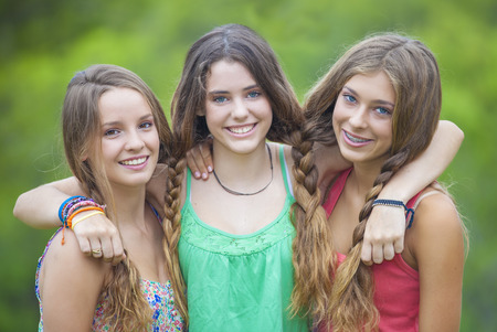 happy smiling group of  teenage girls with white teeth