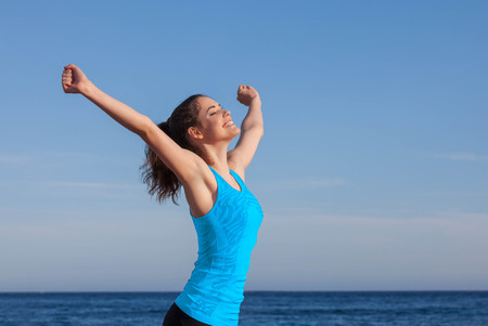 euphoric: happy person arms raised outstretched Stock Photo