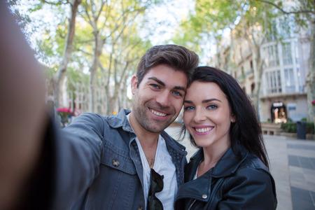 couple of vacation taking selfie in el Borne Palma de Mallorca