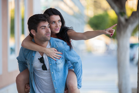 happy couple on vacation or holiday giving  piggyback Stockfoto
