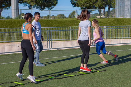 fitness instructor outdoors exercise