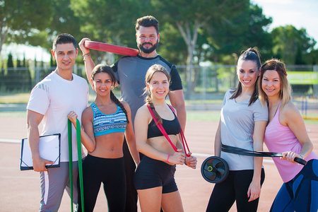 fitness class with gym equipment and trainer. Stockfoto