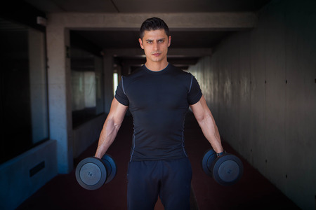 strong healthy man with gym weights