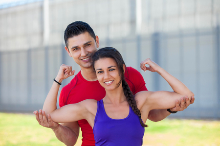 fit athletic woman with personal trainer or instructor