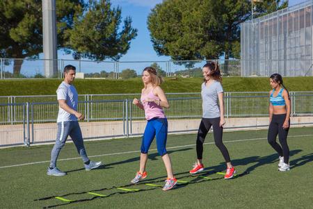 gym teacher exercise class group