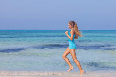 woman exercising on beach seashore in summer.  Stock fotó