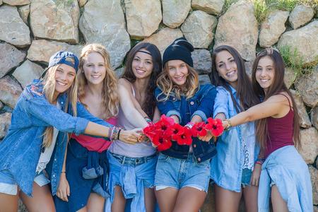 denim jeans: group of girls at music festival   Stock Photo