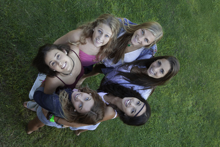 healthy looking: circle of healthy happy smiling  teens looking up Stock Photo