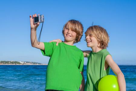 kids taking selfie on summer holiday in Mallorca Spain