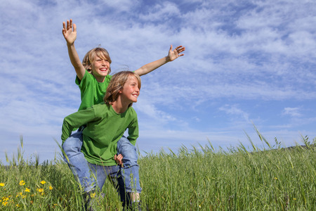 healthy kids playing outdoors in summer Stockfoto