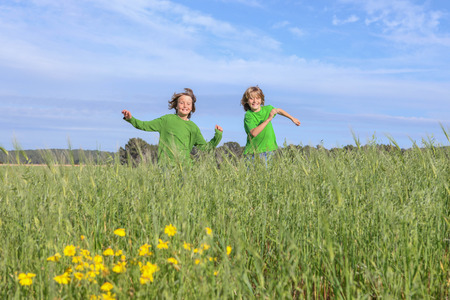 happy healthy kids running, playing, outdoors in summer Stockfoto