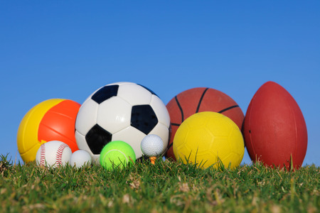 collection of different types of sports  balls.