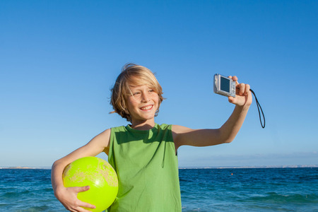 happy kid on summer holiday taking selfie photo in Mallorca