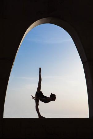 ballet dancer pose silhouette  outdoors.