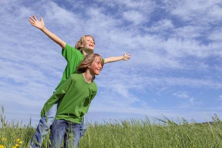 healthy summer piggyback kids in summer photo