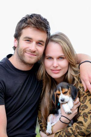 attractive couple with family pet puppy dog