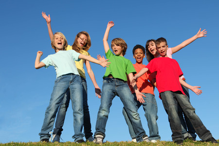 diversity kids or childrens group hands raised photo