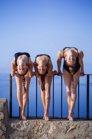 gymnasts, dancers outdoors stretching