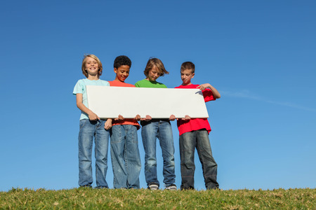 holding blank sign: diverse kids holding blank sign Stock Photo