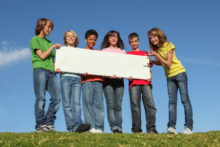 group of diversity children with blank white sign poster Stockfoto