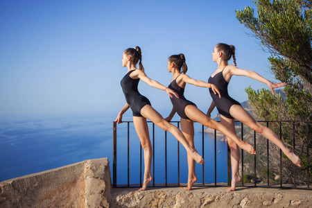 dance pose: gymnastic or ballet dance pose, healthy girls,