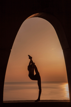 silhouette of gymnast outdoors.