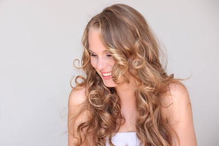 pretty woman, blond curly hair beautiful skin  Standard-Bild
