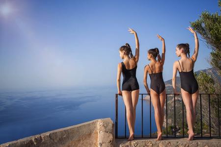 supple, fit healthy dancers exercising outdoors. Stock fotó