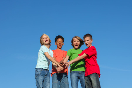group of diverse kids or teens hands together photo