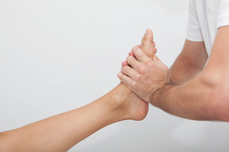 relaxing foot massage therapy Stock Photo