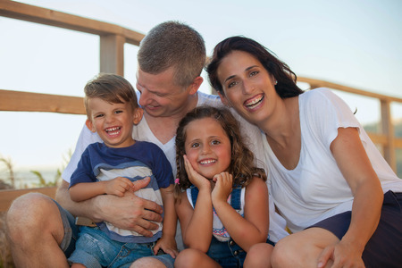 happy smiling family on summer vacation parents and kids Stockfoto