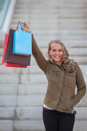 woman shopper with shopping bags or gifts.  Stockfoto