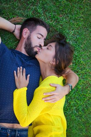 romantic loving couple in love kissing on grass Stockfoto