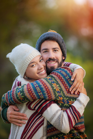 young couple hugging in autumn