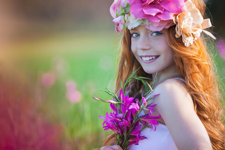 pretty summer girl with crown of flowers and beautiful skin and teeth
