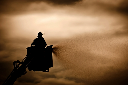 hose: Silhouette of Firemen fighting  Stock Photo