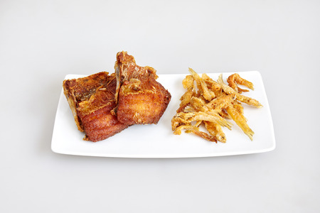Tilapia fish fried and white bait fish fried - top view