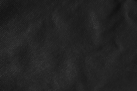 Black synthetic fabric texture background