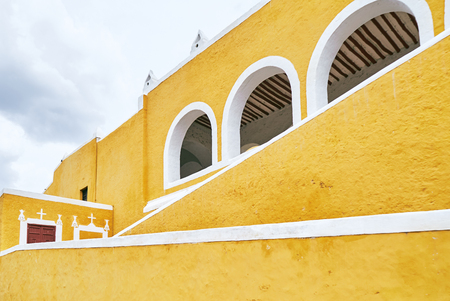 YUCATAN, MEXICO - MAY 31, 2015: Facade of the church, the yellow city of Izamal
