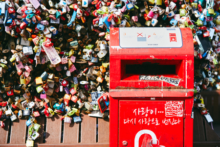 Seoul, South Korea - October 8, 2014: The close-up of a red post box of letter in the lock love key area at Namsan Tower (N-Seoul Tower) Editorial