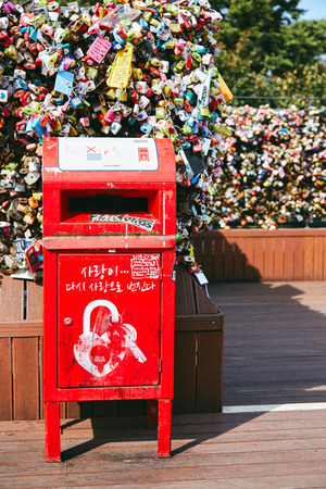 Seoul, South Korea - October 8, 2014: The red post box of letter in the lock love key area at Namsan Tower (N-Seoul Tower)